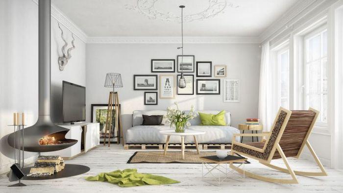 wohnzimmer gestalten, fotowand über dem sofa, hängelampe, graues rundes kamin, vase mit blumen