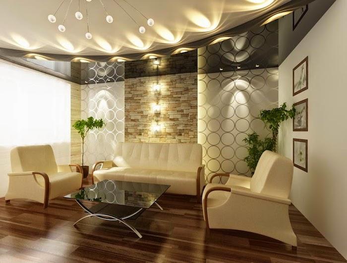 wohnzimmer gestalten, zwei sessel und ein sofa, kleine grüne bäume, steinwand