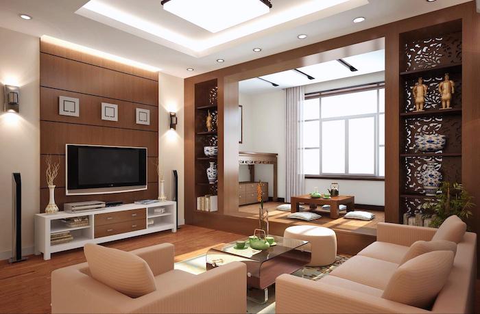 wohnzimmer gestalten, feng shui einrichtung in braun, kleine statuen, kaffeetisch aus glas und golt