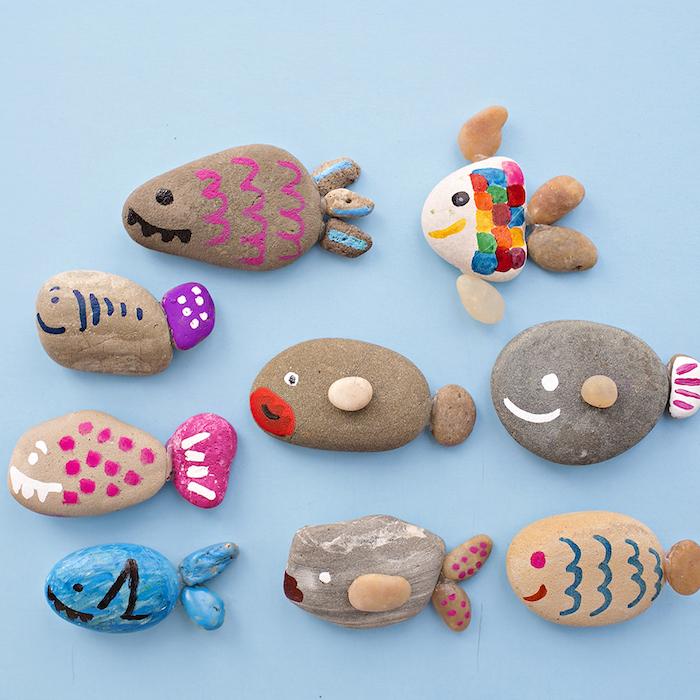 Tolle DIY Idee für Kinder, Steine mit Filzstiften bemalen, bunte Fische gestalten
