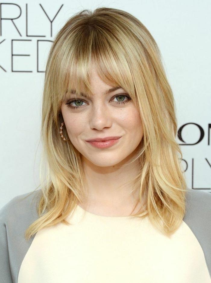 blonde Haare, blaue Augen, rote Lippen, ein natürliches Aussehen, welche Frisur steht mir