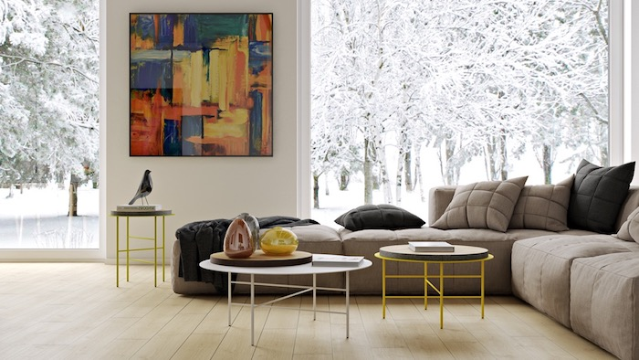 großes buntes bild, kleiner vogel, dekoideen wohnzimmer, runde kaffeetische