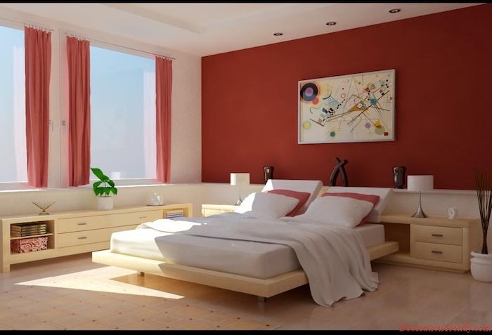 wandfarbe schlafzimmer, ein bett mit einer weißen decke und mit roten und weißen kissen und eine große rote wand, schlafzimmer streichen ideen