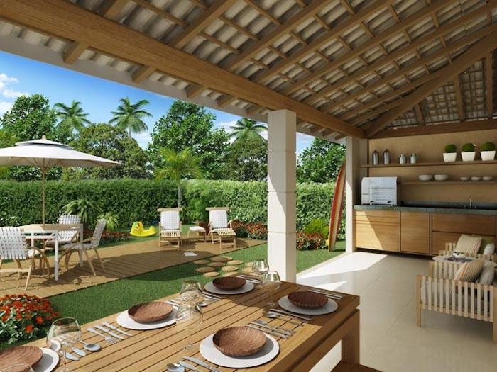 ein garten mit vielen grünen pflanzen und einem grünen rasen, blauer himmel und ein großer weißer sonnenschirm und weiße stühle, eine außenküche im garten bauen