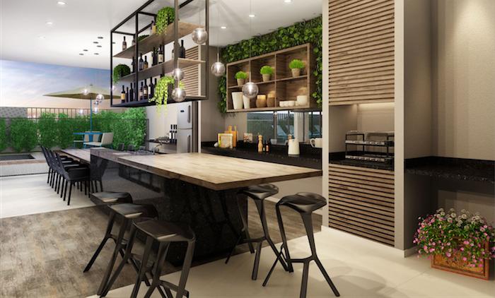 eine terrasse mit einer outdoor küche mit einem braunen tisch aus holz und mit vielen stühlen, kleine blumentopfe mit grünen und violetten blumen