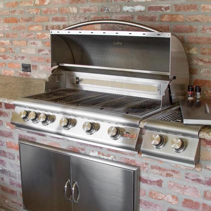 eine küche mit einem elektroherd und mit einem backofen und steinen, eine außenküche selbe r bauen ideen