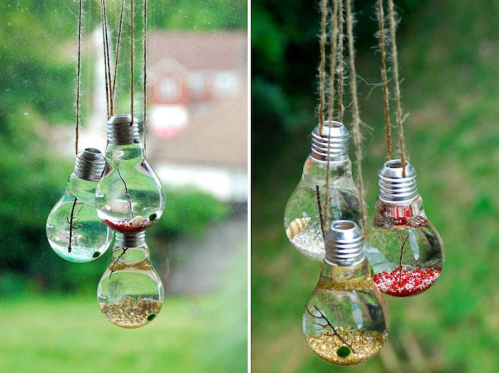 eine gartendekoration mit kleinen alten glühbirnen mit wasser und kleinen ästen, alte glühbirnen recyceln ideen