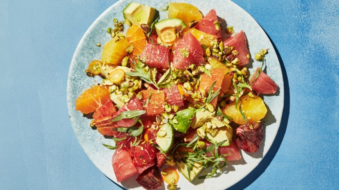 Orange und Grapefruit, Kerne, Petersilien, raffinierte Salate, gemischter Salat