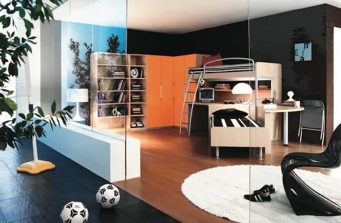 jugendzimmer einrichtung fpr zwei jungen, runder teppich, große glaswände, zwei fußbälle