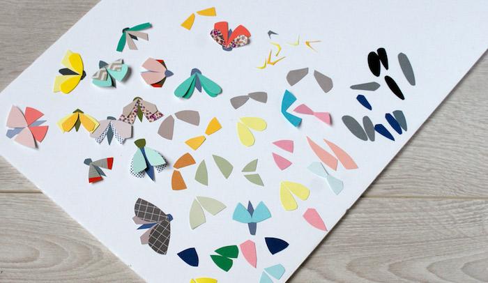 Kleine Schmetterlinge aus buntem Papier ausschneiden, tolle Bastelidee für Kinder