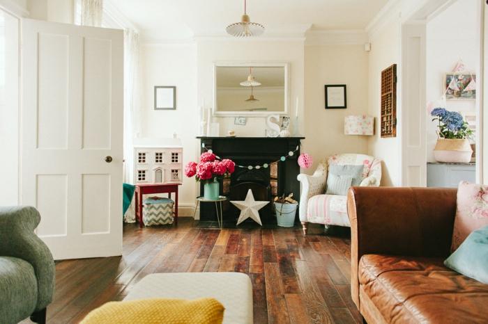 wohnzimmer landhausstil ideen zum einrichten moderne wohnung im ländlichen stil gestalten, ledersofa braun, dekorationen blumen, stern