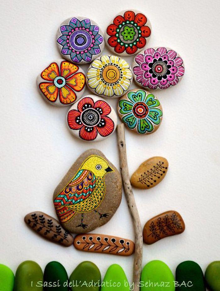 Mit Mandala Steinen Blume gestalten, Vögellein auf Stein zeichnen, mit bunten Farben