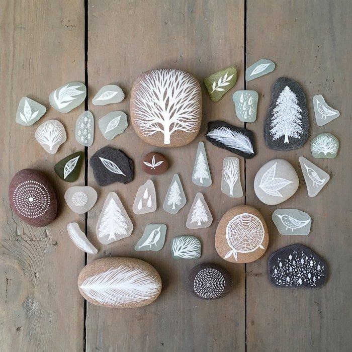 Deko Steine für den Garten, mit weißer Farbe bemalen, verschiedene Motive zeichnen