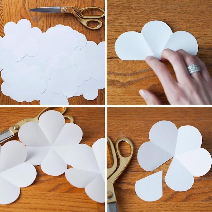 wanddeko selber machen, papierblumen basteln, weißer bastelkarton, silberne ring mit kristallen