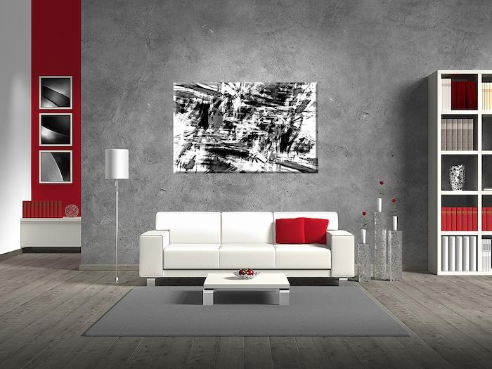 wandgestaltung wohnzimmer, beton muster, abstraktes bild, weißes sofa, rote dekokissen
