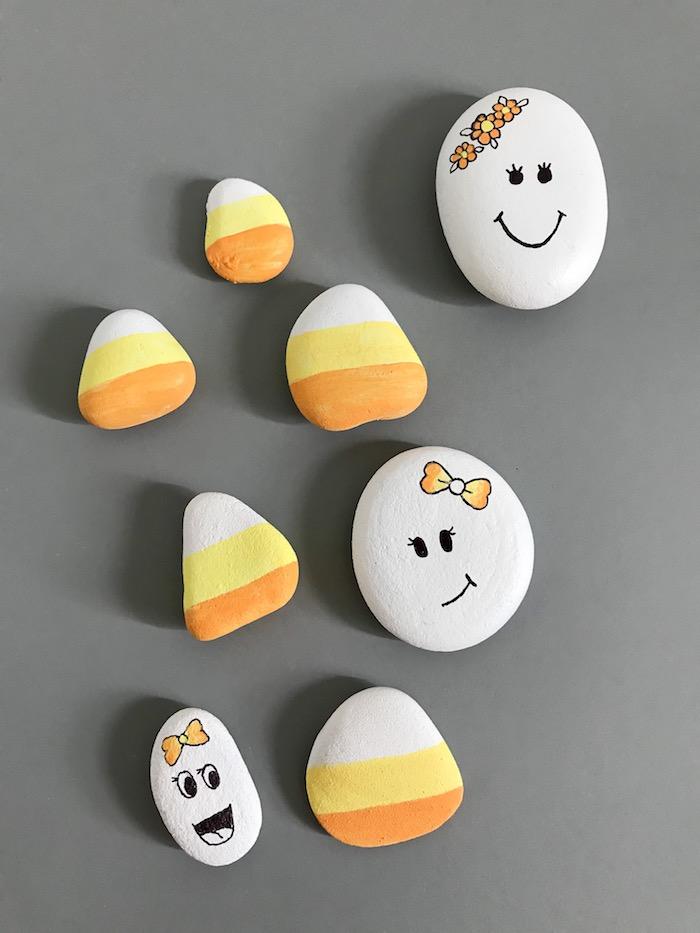 Coole Idee wie man Steine dekoriert, lustige Gesichter zeichnen, mit weißer und gelber Farbe bemalen