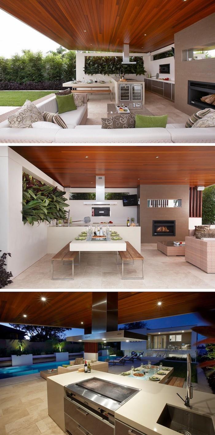 waschbecken und ein kamin und ein elektroherd, einn weißer tsich und bänke aus holz, weißes sofa mit grünen und grauen kissen