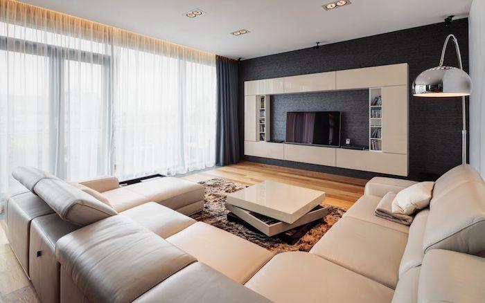 wohnzimmer grau weiß, großer ledersofa, fernsehwand mit schrank, beleuchtung