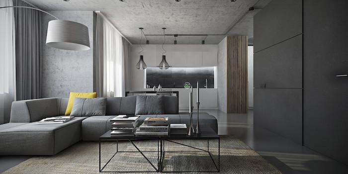 wohnzimmer weiß grau, graues ecksofa mit gelbem dekokissen, weiße küchenschränke