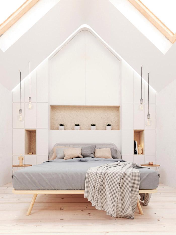 bett unter dachschräge, weiße wände, hängende lampen, graue bettwäsche, kleines schlafimmer