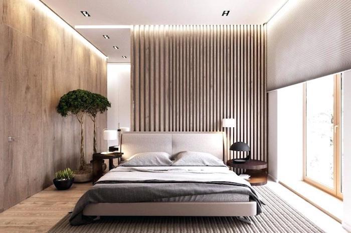 deko ideen schlafzimmer, wand mit led belecuhtung, zwei kleine bäube, gestrickter teppich