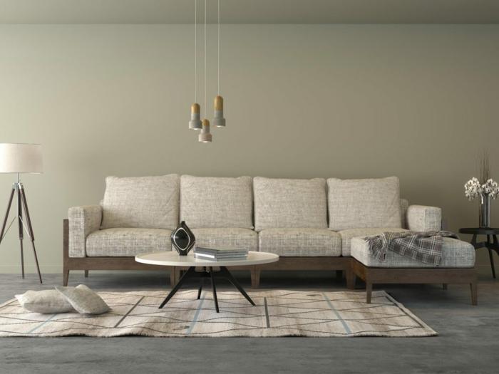 graue Wände, ein graues Sofa, ein weißer Teppich, ein runder Tisch, Pendelleuchte, graue Betonbodenfarbe