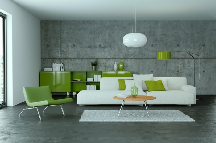 eine grüne Einrichtung, Bodenbelag Betonoptik, weiße Lampe, weißes Sofa und weißer Teppich