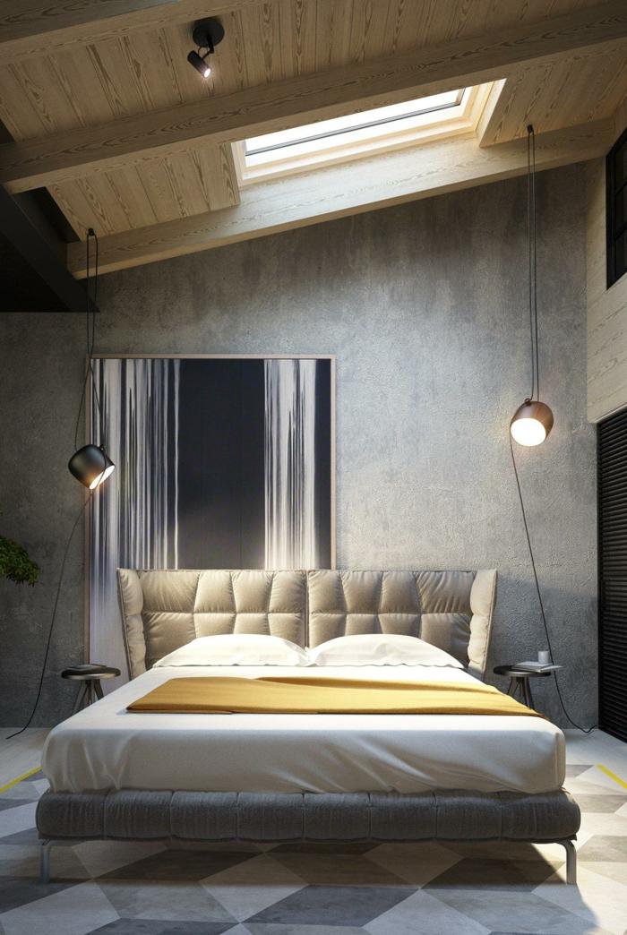 zwei hängende Lampen, ein bequemes beiges Bett, eine Dachwohnung, Bodenbelag Betonoptik