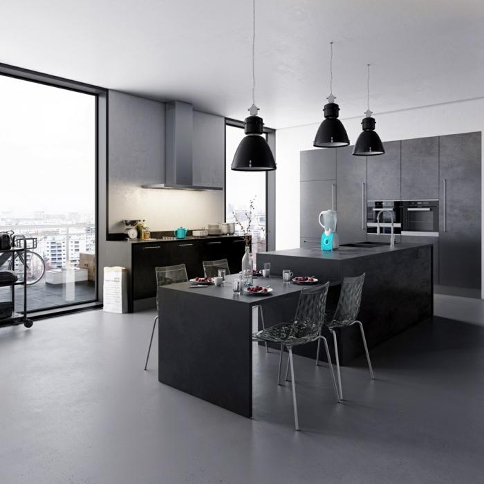 ein graues Zimmer, mit grauem Tisch und grauer Kochinsel, Pendelleuchten, Boden Betonoptik