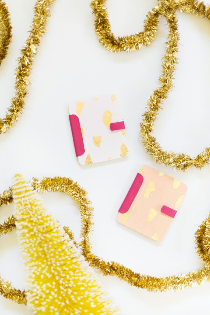 eine weiße und ein rosa Gutschein Verpackung aus Holz, Geschenke schön verpacken