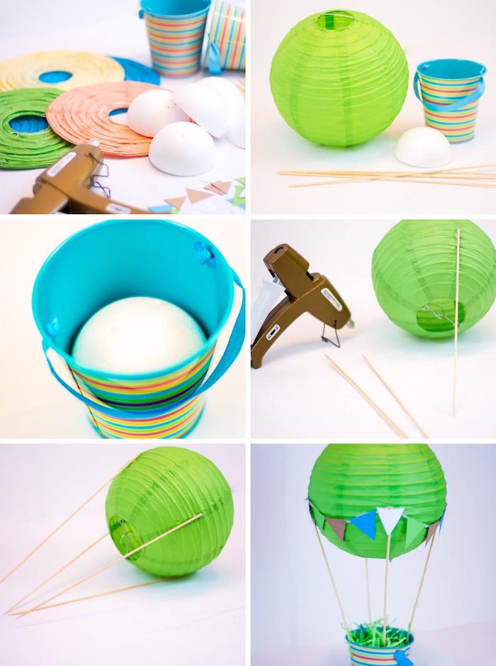 heißluftballon basteln, grüne papierlaterne, blauer eimer mit bunten streifen, styroporbälle