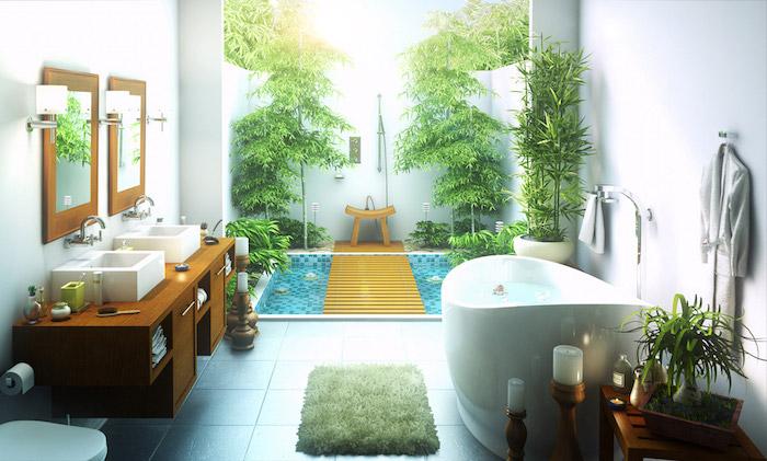boden aus fliesen und eine kleine weiße badewanne, waschbecken und kleine weiße kerzen, haus mit einem garten mit schwimmpool und grünen bäumen und pflanzen und einer gartendusche