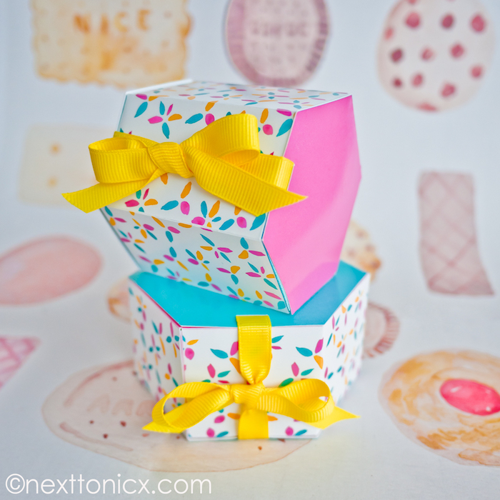 origami schachtel aus buntem papier, gelbe schleife, geschenkverpackung selber machen