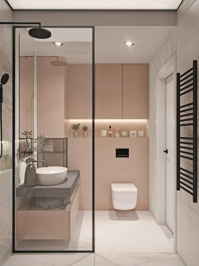 ein kleines Badezimmer mit Deckenleuchten, weißem Fliesenboden, ein rundes Waschbecken, Badideen