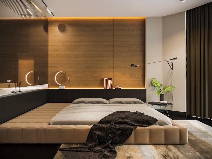 schlafzimmer gestalten, großes beige bett, wand mit led beleuchtung, grüne pflanze, einrichtung in naturfarben