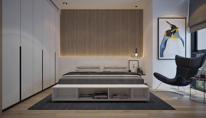 schlafzimmerwand gestalten, 3d wand mit led beleuchtung, bett mit unterschrank, schwarzer lesesessel