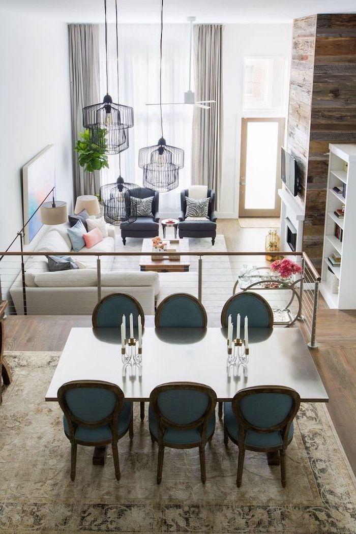 wohnzimmer ideen modern, teppich auf dem boden im essbereich, sechs stühle am tisch. blick von oben über dem wohnzimmer