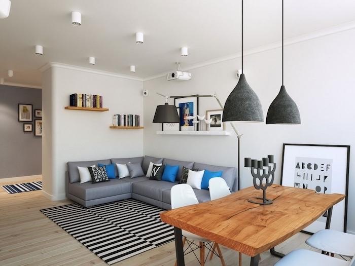 schöne bilder wohnzimmer ideen, teppich mit schwarzen und weißen streichen, schwarze lampen, graues sofa, bunte kissen
