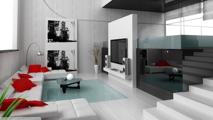 wohnzimmer inspiration von der meerestiefe, weißes sofa, rote kissen, schwarzer kleiner tisch, weiße deko, treppe, bilder