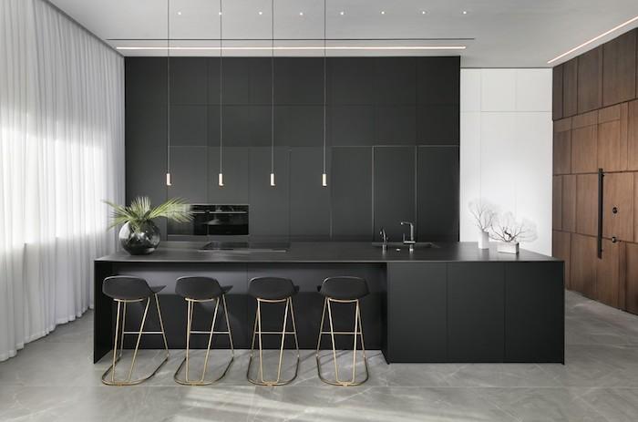 die küche abteilung in einem wohnraum, wo wohnzimmer, esszimmer und kochinsel stehen
