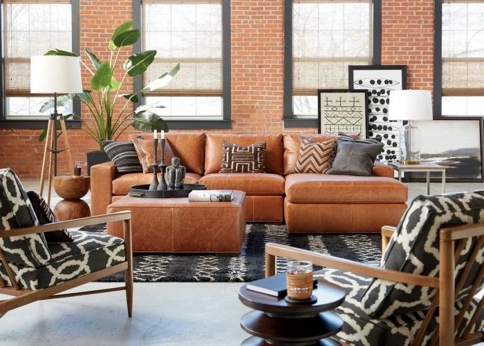 moderne wohnzimmer einrichtung, schwarz und weiß motive geometrisch dessin von möbeln und dekorationen, rot braun orange möbel farbmischung