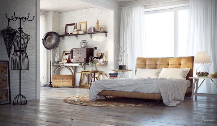 wohnung einrichten, schlafzimmer in modernem industrial stil, großes lederbett, runder teppich