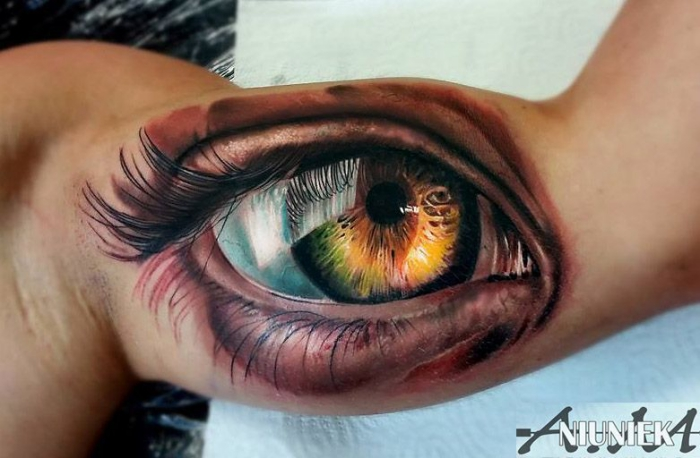 beste tattoos, farbige 3d tätowierung, große auge, frauenauge am oberarm