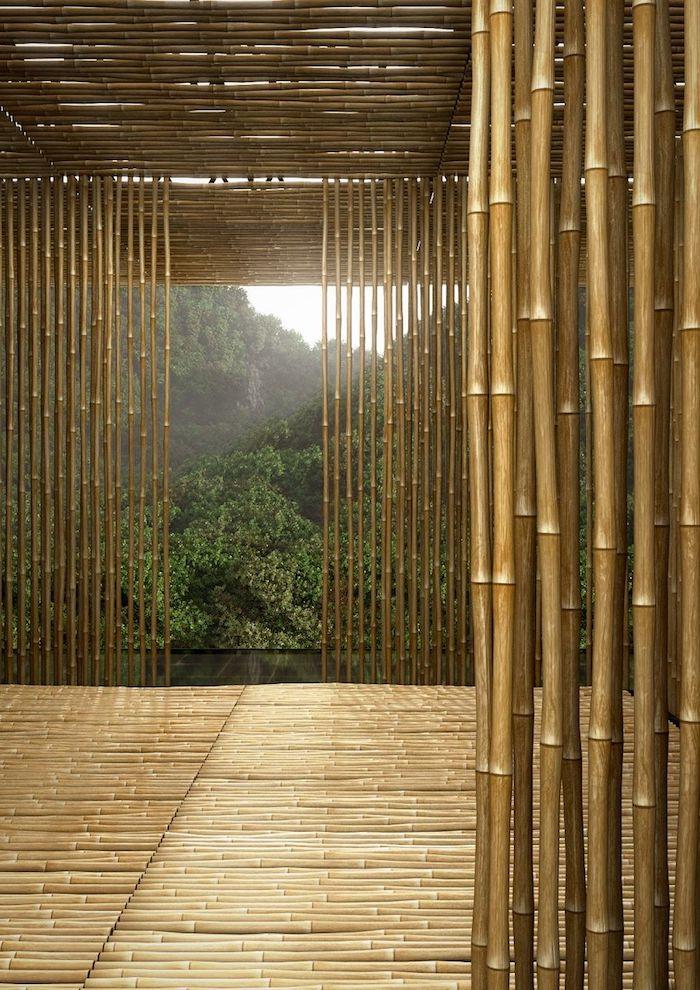 einen sichtschutz aus vielen braunen und langen bambus stäben selber bauen, ein garten mit grünen bäumen, garten sichtschutz selber bauen