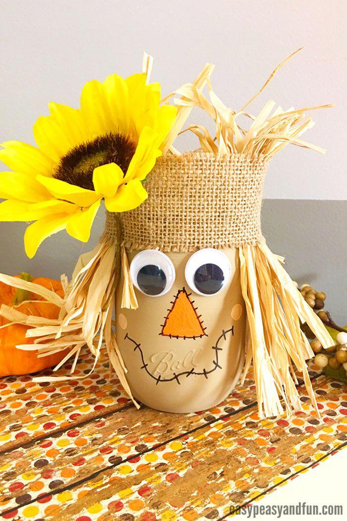 halloween bastelideen, kopf aus stroh, und weinmachglas, strohmann selber machen, sonnenblume