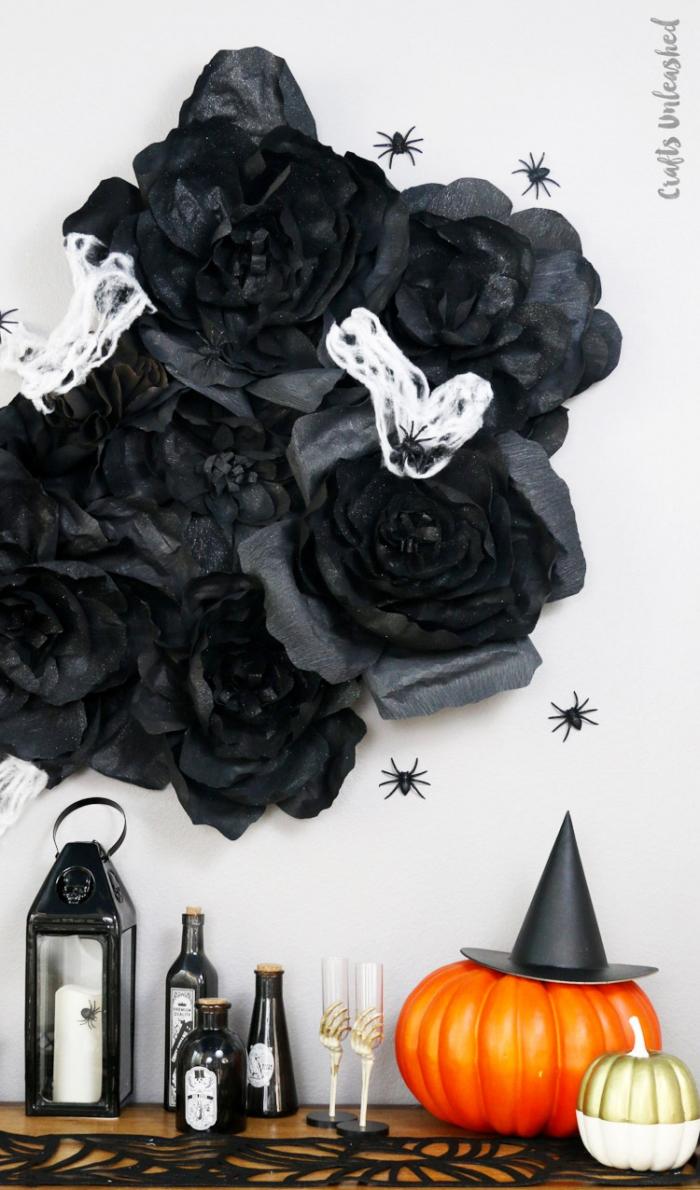 halloween deko ideen, große schwarze blumen aus seidenpapier, bastlen mit papier, wanddeko