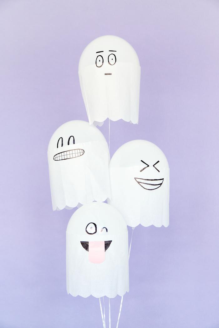 Vier lustige Gespenster aus weißen Luftballons und Papier, Halloween Deko selber machen