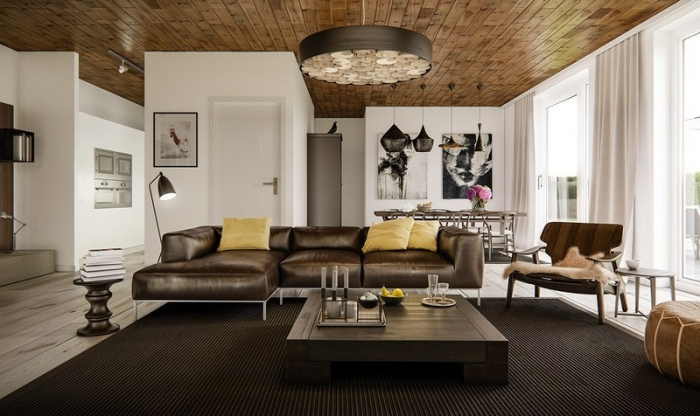 haus einrichten, designer ledersofa in braun, bilder als wanddeko, decke mit holzdielen, landhausstil modern