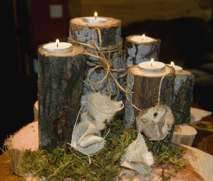 rustikale Dekoration für die Hochzeit, alles für die Hochtzeit, kleine Teelichter auf Stämme