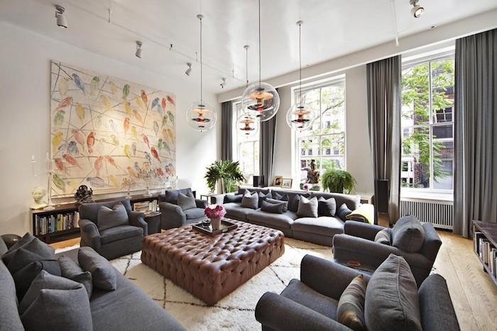 fertig häuser innengestaltungsideen, sofas und sesseln, wanddeko großes bild, braun